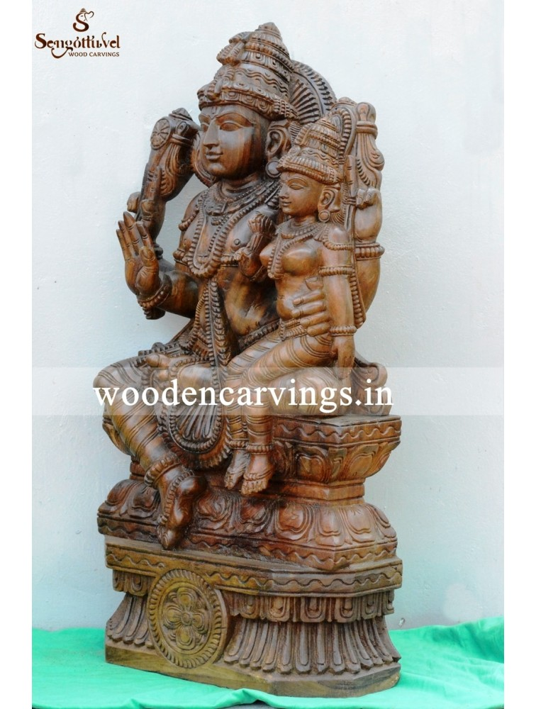 Goddess Lakshmi Seated On Lord Vishnu's Lap