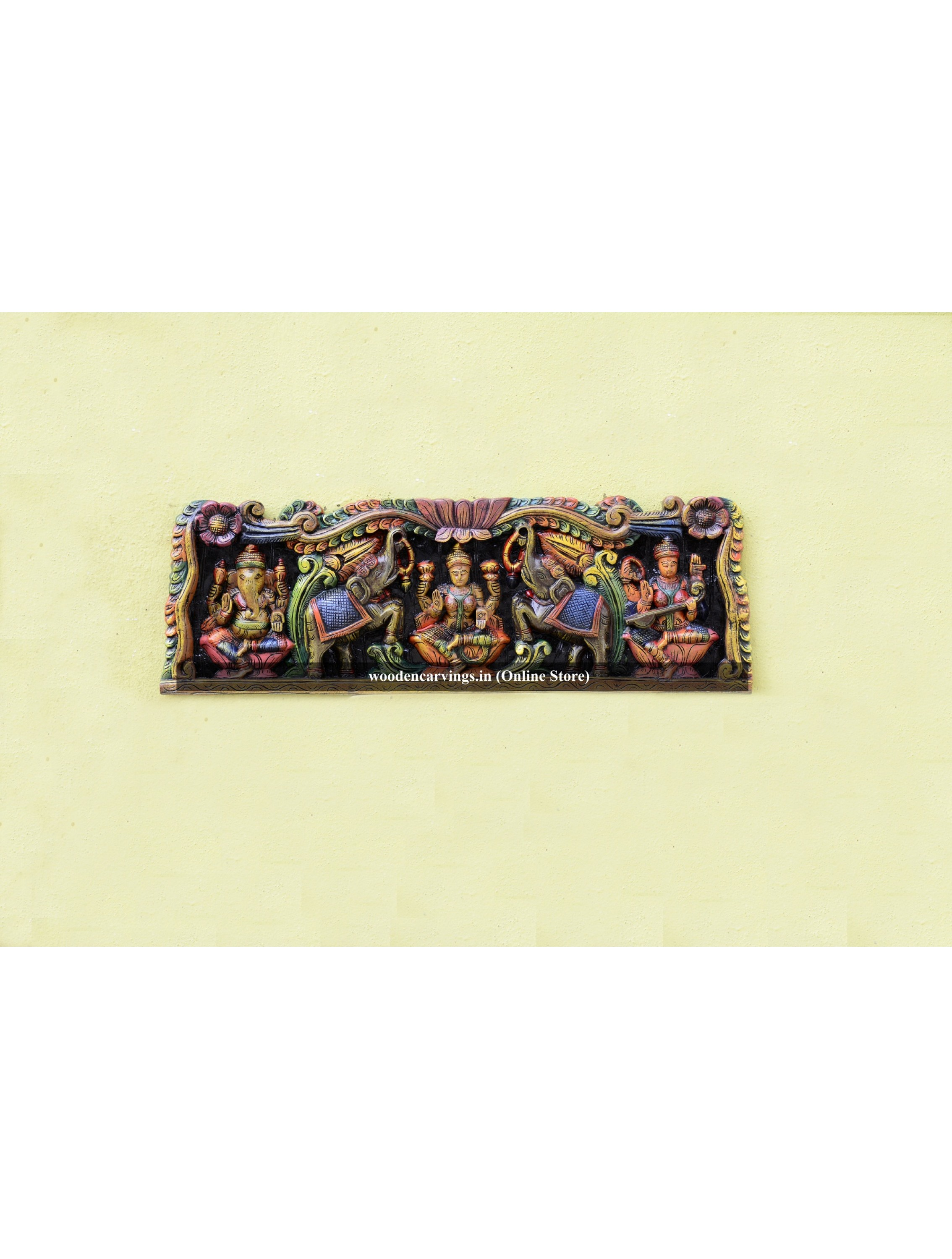 Multicoloured Ganapathi,Lakshmi devi and Saraswathi wooden wall deity