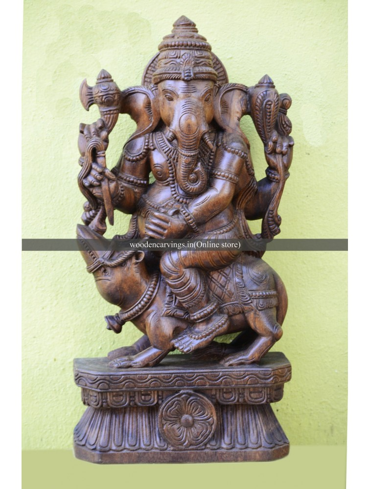 Lord Ganapathi riding Mooshak (Rat) Wooden Sculpture