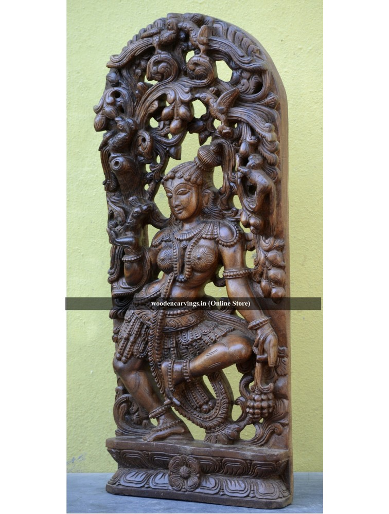 Beautifully carved wooden Apsaras