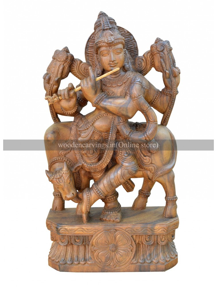 Wooden statue of Lord Krishna