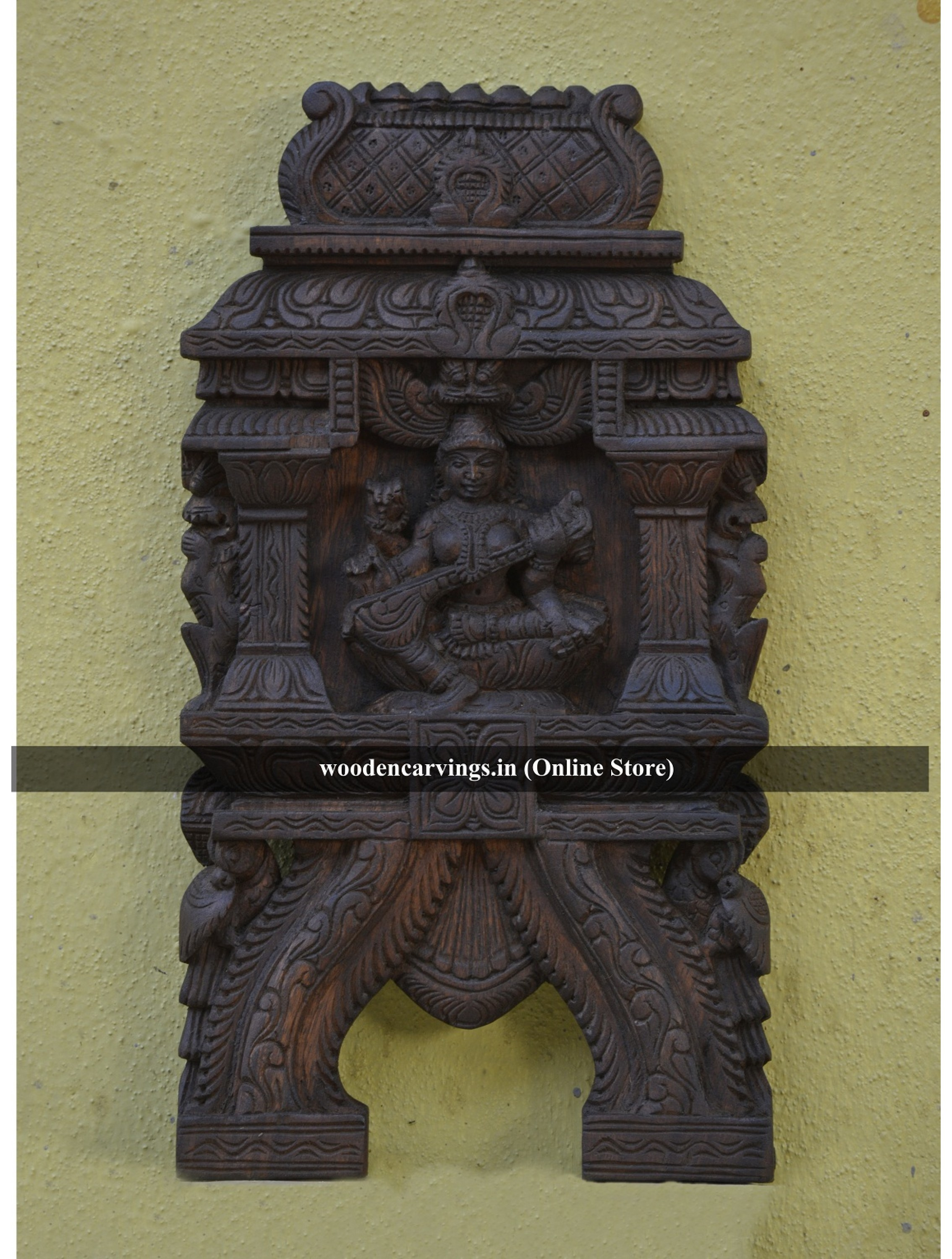 Buy wooden wall mounting kaavadi of Goddess Saraswathi