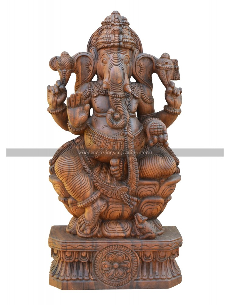 Buy An Wooden Idol Of Elegant Ganesha Seated On the Lotus