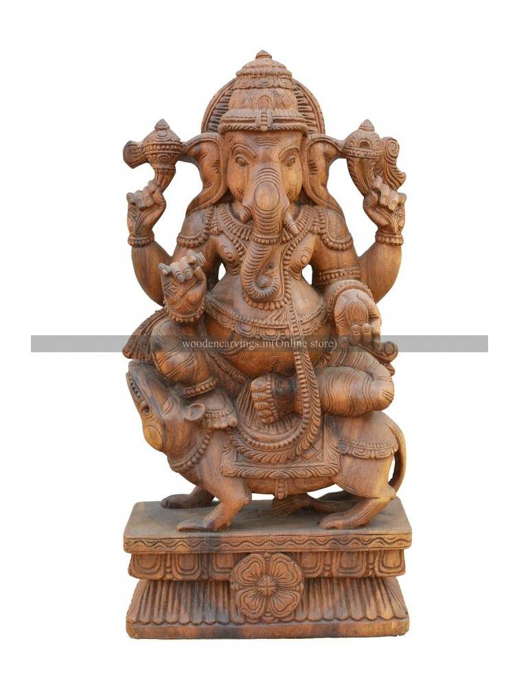 Wooden Statue Of Lord Ganesha Seated On the Top Of Mooshiak